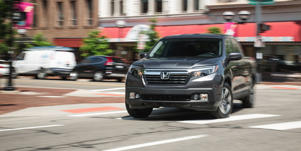 Long-Term Test Intro: Honda's Ridgeline Signs on for 40,000 Miles: We named the Honda Ridgeline the best mid-size pickup, but how will it stack up during a 40,000-mile long-term test? Read more and see pictures at Car and Driver.