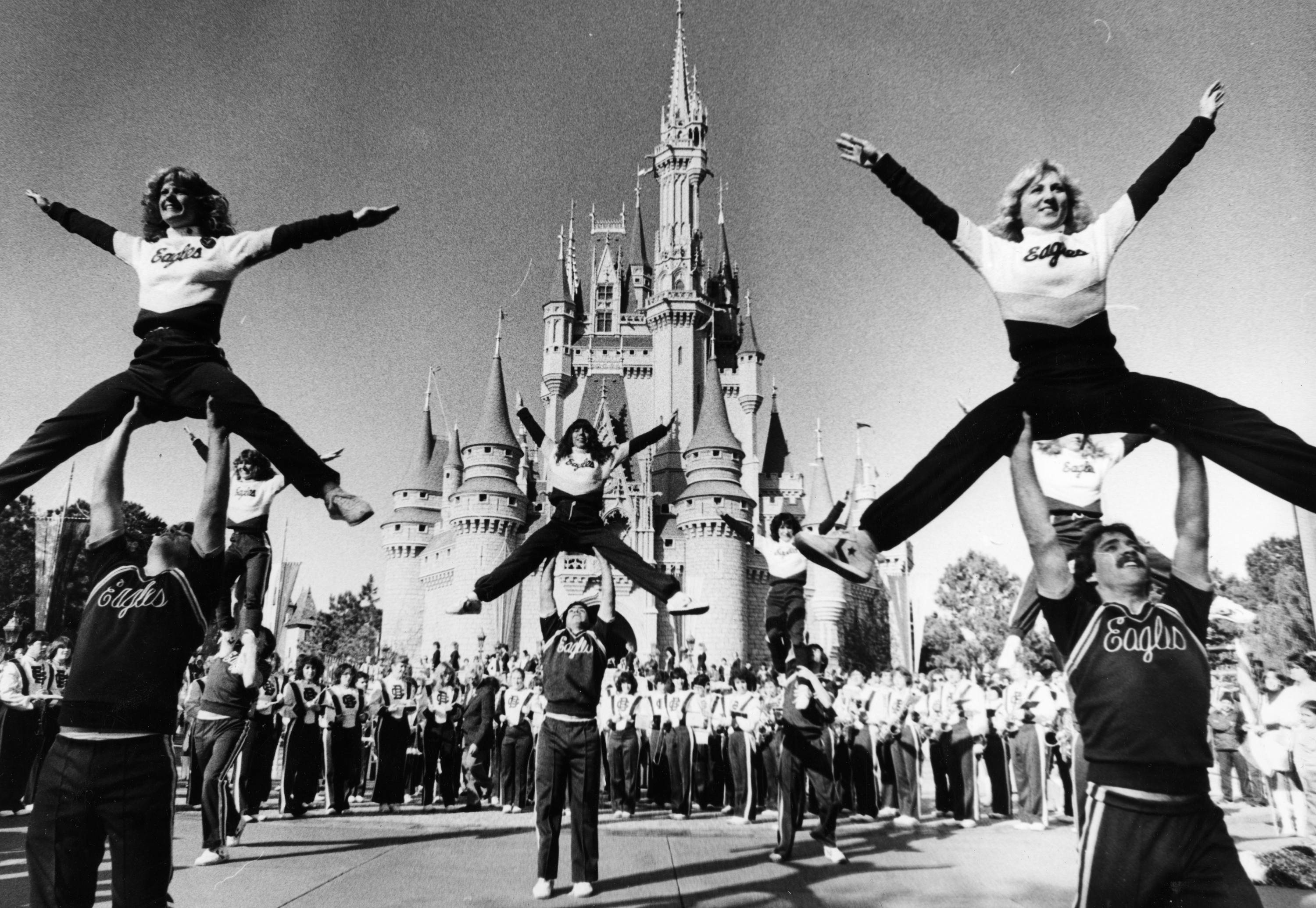 Slide 30 of 33: ORLANDO, FL - DECEMBER 1: Boston College Cheerleaders along with the BC band perform out in front of the Cinderella Castle at in the Magic Kingdom at Walt Disney World in Orlando, December 1982. BC was in town to play Auburn in the Tangerine Bowl. (Photo by John Tlumacki/The Boston Globe via Getty Images)