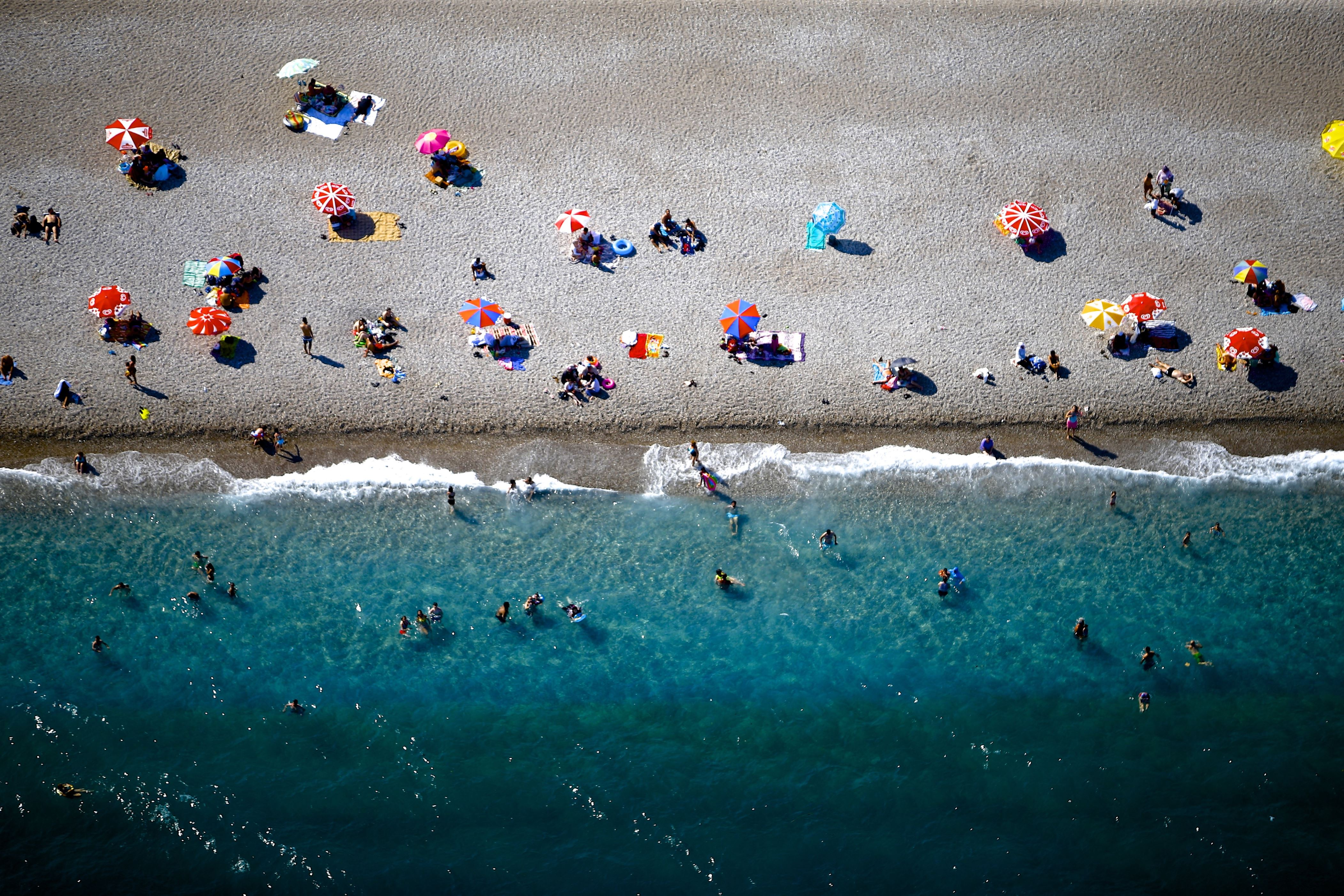 Slide 25 of 39: ANTALYA, TURKEY - JULY 17: An aerial view from a beach in Konyaalti district of Antalya, Turkey on July 17, 2017. Antalya is a home to world-famous beaches and natural beauties. (Photo by Mustafa Ciftci/Anadolu Agency/Getty Images)