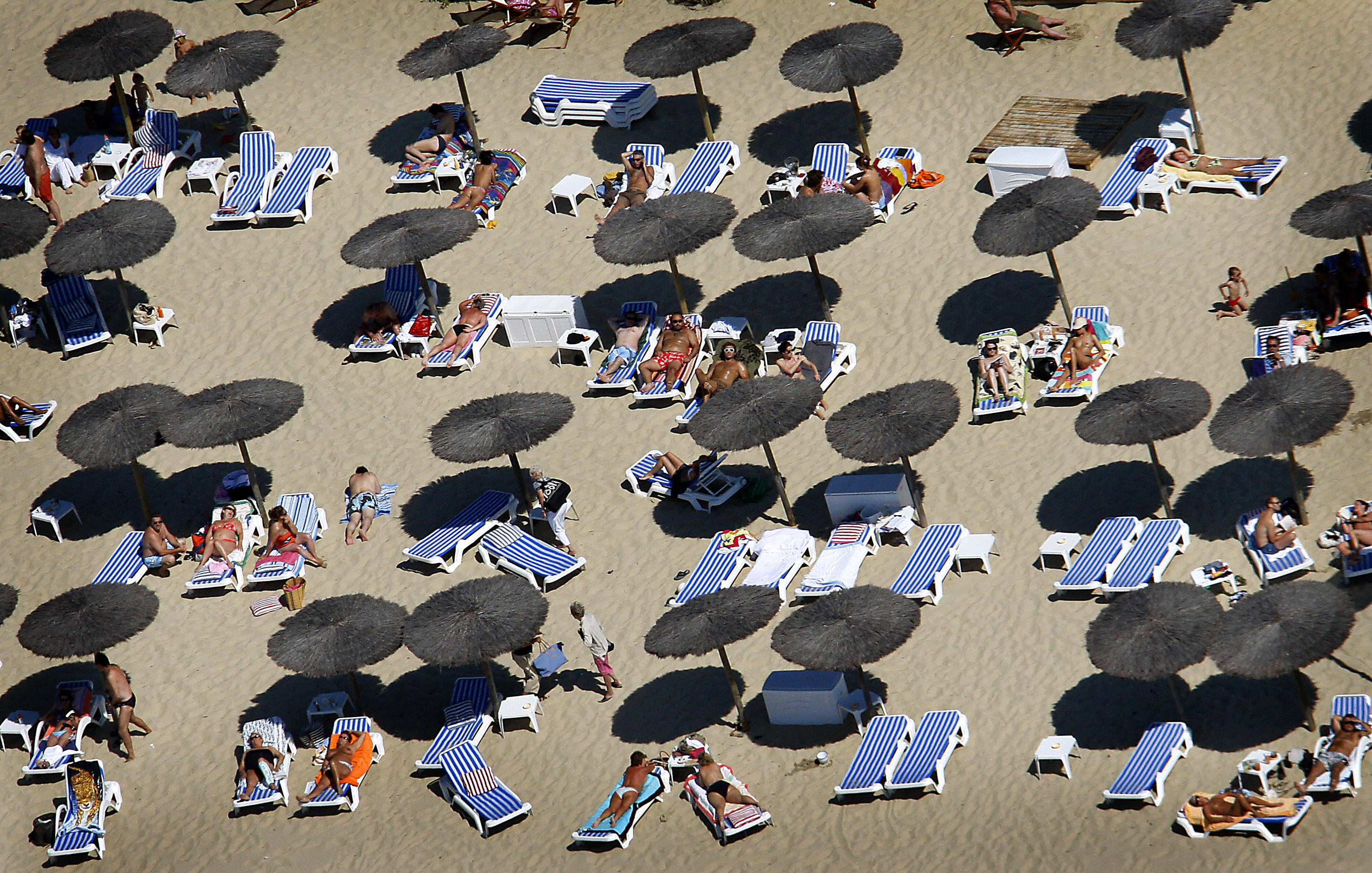 Slide 10 of 39: This aerial photography taken on July 19, 2008 shows people enjoying the beach along the basin of Arcachon, on the French atlantic coast, southwestern France. AFP PHOTO PATRICK BERNARD (Photo credit should read PATRICK BERNARD/AFP/Getty Images)
