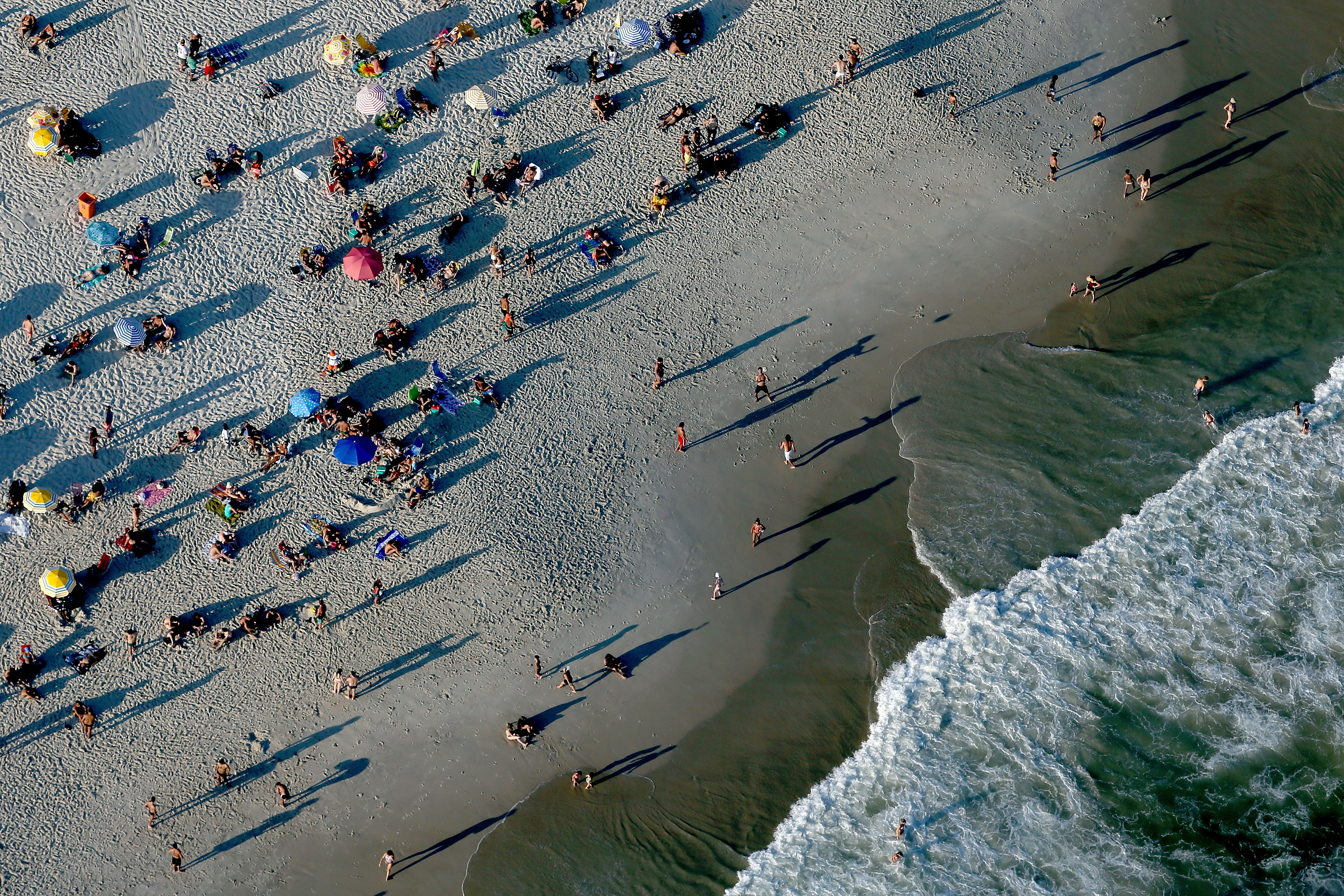 Slide 31 of 39: RIO DE JANEIRO, BRAZIL - FEBRUARY 05: Aerial view of Copacabana Beach with six months to go to the Rio 2016 Olympic Games on February 5, 2016 in Rio de Janeiro, Brazil. (Photo by Matthew Stockman/Getty Images)