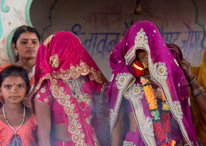 In this April 17, 2017 photo, an underaged bride, right, stands with family members during her marriage at a Hindu temple near Rajgarh, Madhya Pradesh state, India.. A significant fall in child marriages in South Asia has reduced the rate of marriage for girls globally, the U.N. children's agency said Tuesday. (AP Photo/Prakash Hatvalne)