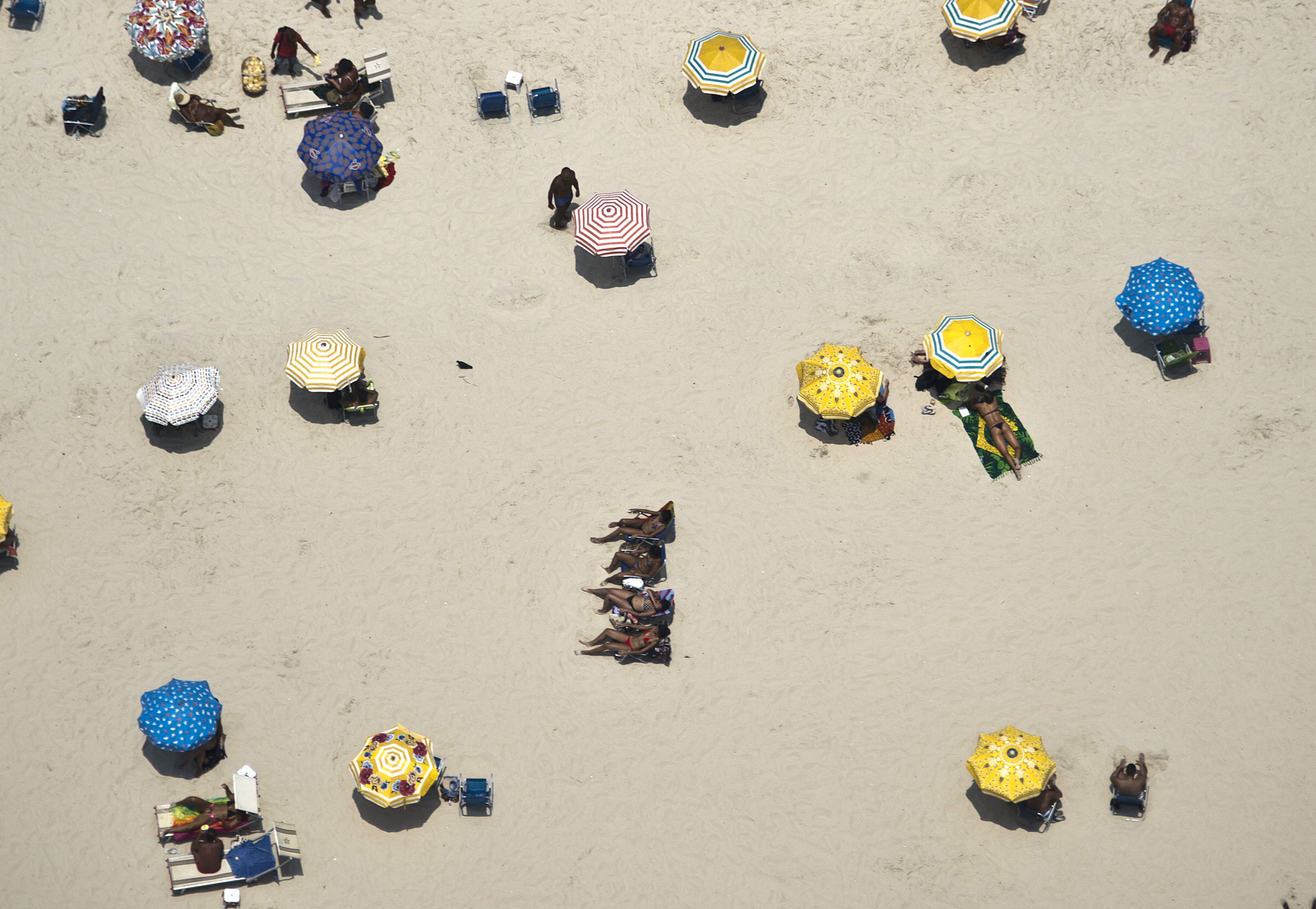 Slide 11 of 39: Aerial view of Copacabana Beach in Rio de Janeiro, Brazil on February 3, 2016. With temperatures reaching the 36-40 degrees Celsius, tourists and residents alike remain on the city beaches until late at night to cool off. AFP PHOTO/VANDERLEI ALMEIDA / AFP / VANDERLEI ALMEIDA (Photo credit should read VANDERLEI ALMEIDA/AFP/Getty Images)