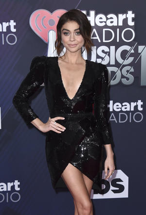 Sarah Hyland arrives at the iHeartRadio Music Awards at The Forum on Sunday, March 11, 2018, in Inglewood, Calif. (Photo by Jordan Strauss/Invision/AP)