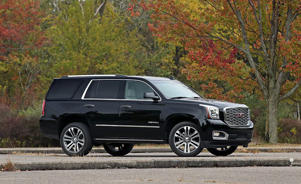 a car parked on the side of a road: 10 Spot: The GMC Yukon Denali Gets a 10-Speed Automatic