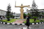 File Photo-A lawyer walks through the compound at the Federal High Court in Ikoyi district in Lagos, Nigeria