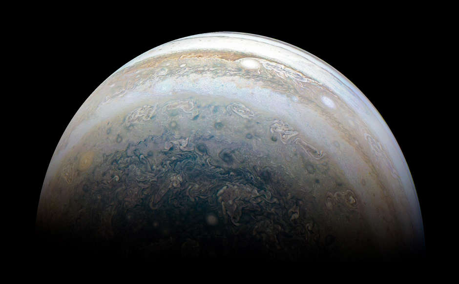 Slide 2 of 82: The color-enhanced image was taken at 11:31 p.m. PDT on May 23, 2018 (2:31 a.m. EDT on May 24), as the spacecraft performed its 13th close flyby of Jupiter. At the time, Juno was about 44,300 miles (71,400 kilometers) from the planet's cloud tops, above a southern latitude of 71 degrees.