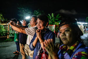CHIANG RAI, THAILAND - JULY 8: Onlookers watch and cheer as ambulances deliver boys rescued from a cave in northern Thailand to hospital in Chiang Rai after they were transported by helicopters on July 8, 2018 in Chiangrai, Thailand. Divers began an effort to pull the 12 boys and their soccer coach on Sunday morning after they were found alive in the cave at northern Thailand. Videos released by the Thai Navy SEAL shows the boys, aged 11 to 16, and their 25-year-old coach are in good health in Tham Luang Nang Non cave and the challenge now will be to extract the party safely.