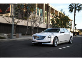 a car parked in front of a building: 2018 Cadillac CT6