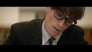a man wearing glasses: The Official Trailer for The Theory of Everything In Cinemas New Year's Day, 2015 http://www.thetheoryofeverythingmovie.co.uk  Subscribe to our channel - http://po.st/UniversalPicturesUK  The Theory of Everything is the story of the most brilliant and celebrated physicist of our time, Stephen Hawking, and Jane Wilde the arts student he fell in love with whilst studying at Cambridge in the 1960s.     Little was expected from Stephen Hawking, a bright but shiftless student of cosmology, given just two years to live following the diagnosis of a fatal illness at 21 years of age.  He became galvanized, however, by the love of fellow Cambridge student, Jane Wilde, and he went on to be called the successor to Einstein, as well as a husband and father to their three children.  Over the course of their marriage as Stephen's body collapsed and his academic renown soared, fault lines were exposed that tested the lineaments of their relationship and dramatically altered the course of both of their lives.  The Theory Of Everything Official Trailer