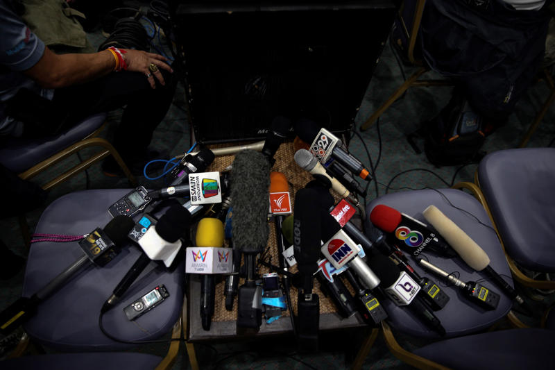 Microphones belonging to media organizations are pictured during a news conference at the Chiang Rai Prachanukroh hospital, in Chiang Rai, Thailand, July 10, 2018. REUTERS/Athit Perawongmetha