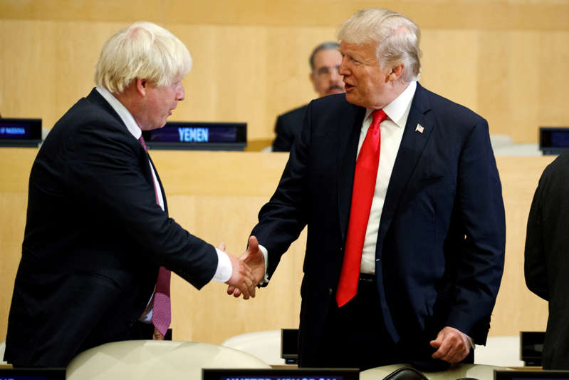 """President Donald Trump shakes hands with British Minister of Foreign Affairs Boris Johnson during the """"Reforming the United Nations: Management, Security, and Development"""" meeting during the United Nations General Assembly, Monday, Sept. 18, 2017, in New York. (AP Photo/Evan Vucci)"""