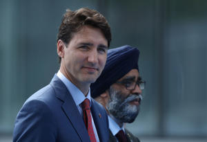 Canadian Prime Minister Justin Trudeau and Canadian Defense Minister Harjit Sajjan arrive at the 2018 NATO Summit in Brussels, Belgium, on July 11, 2018.