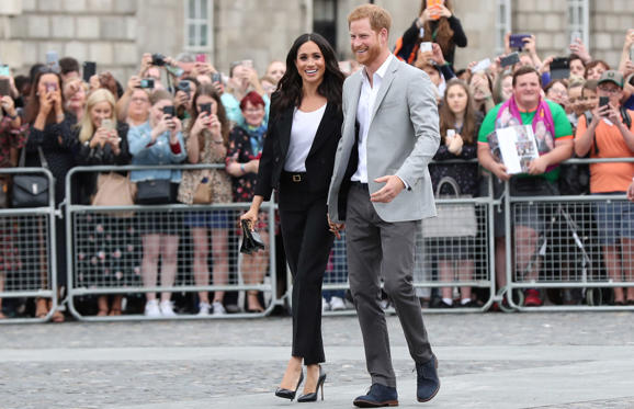 Slide 1 of 68: CAPTION: Britain's Prince Harry and Meghan, the Duchess of Sussex walkabout during a visit to Trinity College in Dublin, Ireland, July 11, 2018. Gareth Fuller/Pool via REUTERS