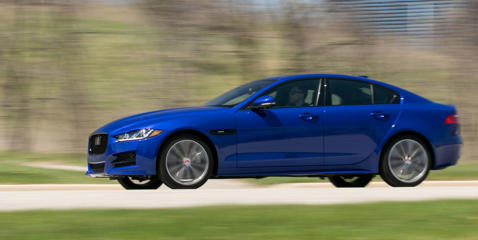 Jaguar adds all-wheel drive and its new homegrown turbo four to its entry-level sedan. Read our review and see photos at Car and Driver.