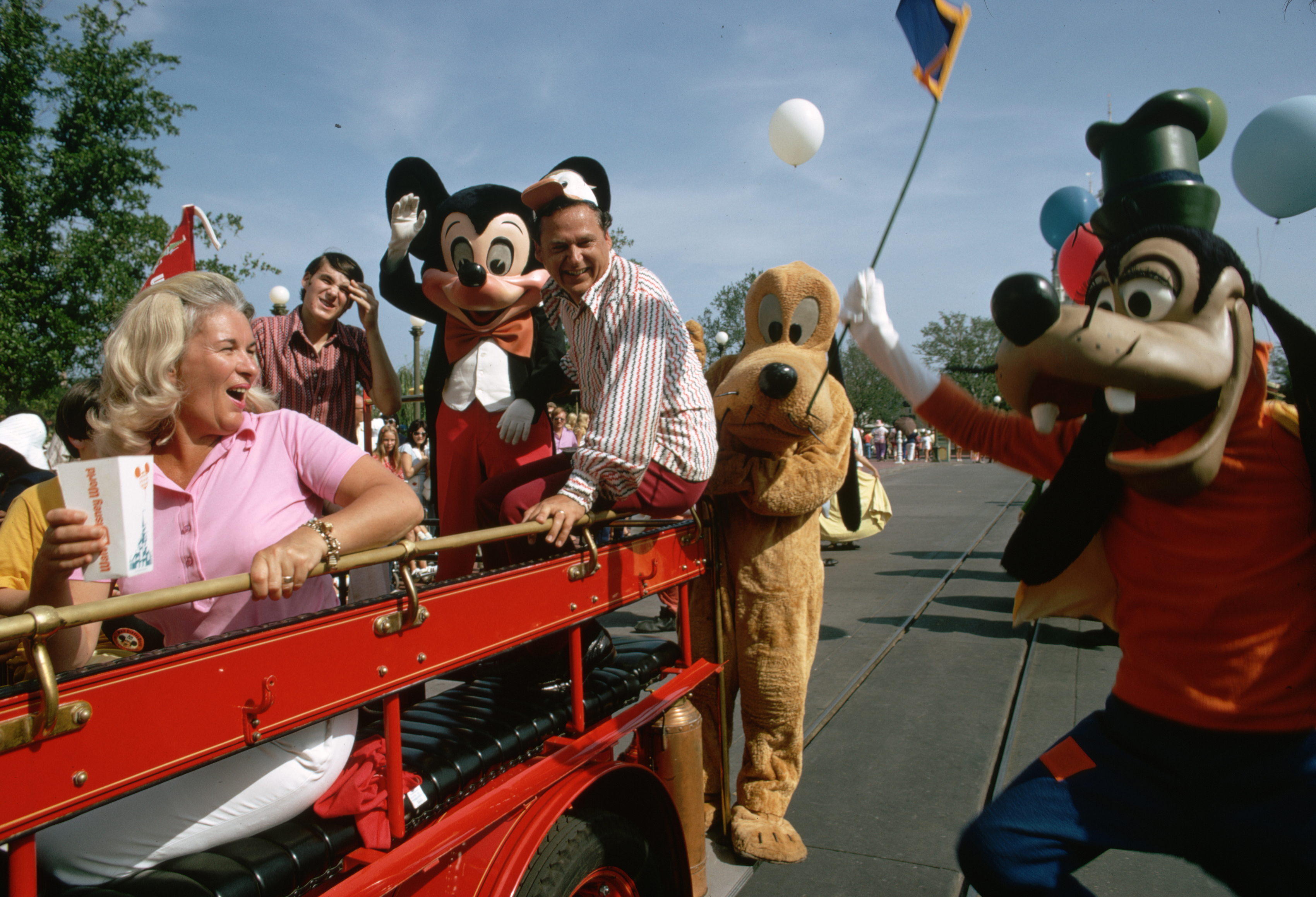 Slide 28 of 33: Tourists and Disney Characters in Parade (Photo by Jonathan Blair/Corbis via Getty Images)
