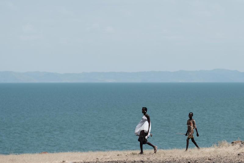 People walk near the Lake Turkana, the world's largest desert lake.