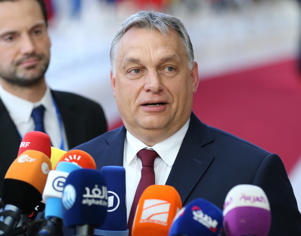 Prime Minister of Hungary Viktor Orban speaks to journalists before entering the meeting hall during the EU Leaders summit in Brussels, Belgium, 28 June 2018.