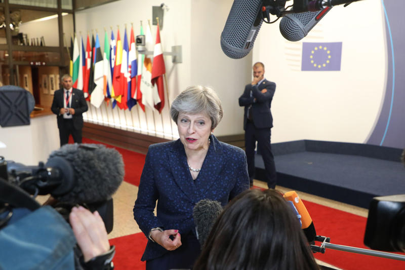British Prime Minister Theresa May speaks to the press before leaving the first day of a European Union leaders' summit focused on migration, Brexit and eurozone reforms in Brussels on June 29, 2018. - European Union leaders reached a crucial deal on steps to tackle migration during all-night talks on June 29 after resolving a bitter row with Italy's hardline new premier. (Photo by Ludovic MARIN / AFP)        (Photo credit should read LUDOVIC MARIN/AFP/Getty Images)
