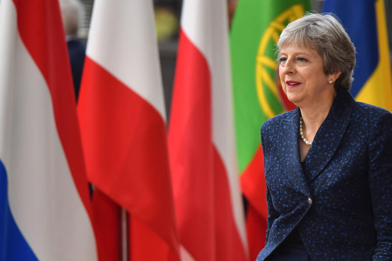 Britain's Prime Minister Theresa May arrives to take part in an European Union leaders' summit focused on migration, Brexit and eurozone reforms on June 28, 2018  at the Europa building in Brussels. - The two-day meeting in Brussels is expected to be dominated by deep divisions over migration, with German Chancellor saying the issue could decide the fate of the bloc itself. (Photo by Ben STANSALL / AFP)        (Photo credit should read BEN STANSALL/AFP/Getty Images)