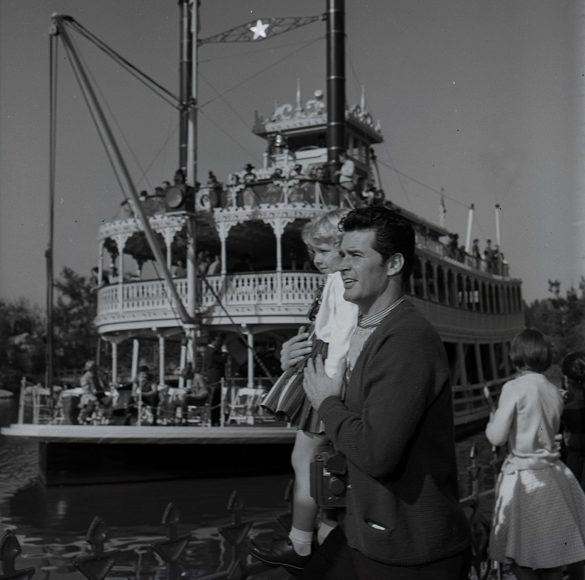 Slide 12 of 33: MAVERICK - James Garner and Family at Disneyland - Shoot Date: December 12, 1957. (Photo by ABC Photo Archives/ABC via Getty Images) JAMES GARNER WITH DONNA MONROE, FRIEND OF STEPDAUGHTER KIM
