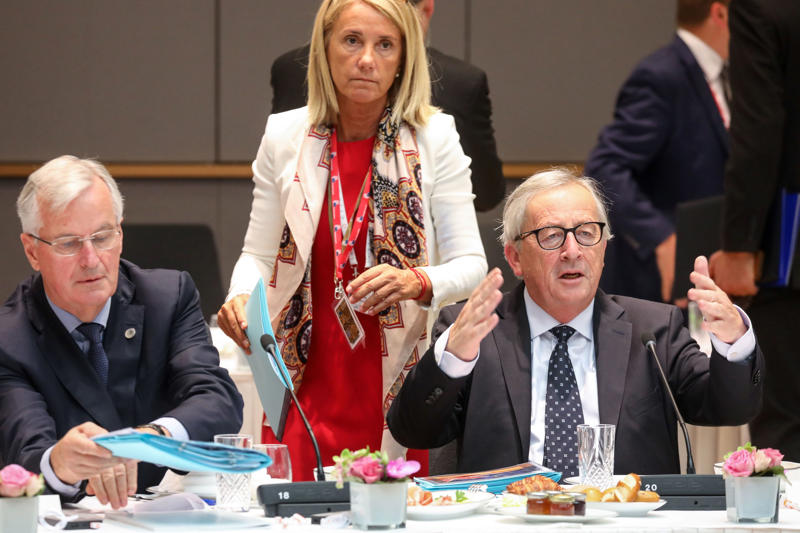 Brexit Chief Negotiator Michel Barnier (L) and President of the European Commission Jean-Claude Juncker sit during the last day of the European Union leaders' summit, without Britain, to discuss Brexit and eurozone reforms on June 29, 2018 at the Europa building in Brussels. - EU leaders clinched a hard-won migration deal during all-night talks on June 29, that Italy's hardline new premier said meant his country was 'no longer alone' in shouldering the responsibility for migrants. (Photo by Ludovic MARIN / AFP)        (Photo credit should read LUDOVIC MARIN/AFP/Getty Images)
