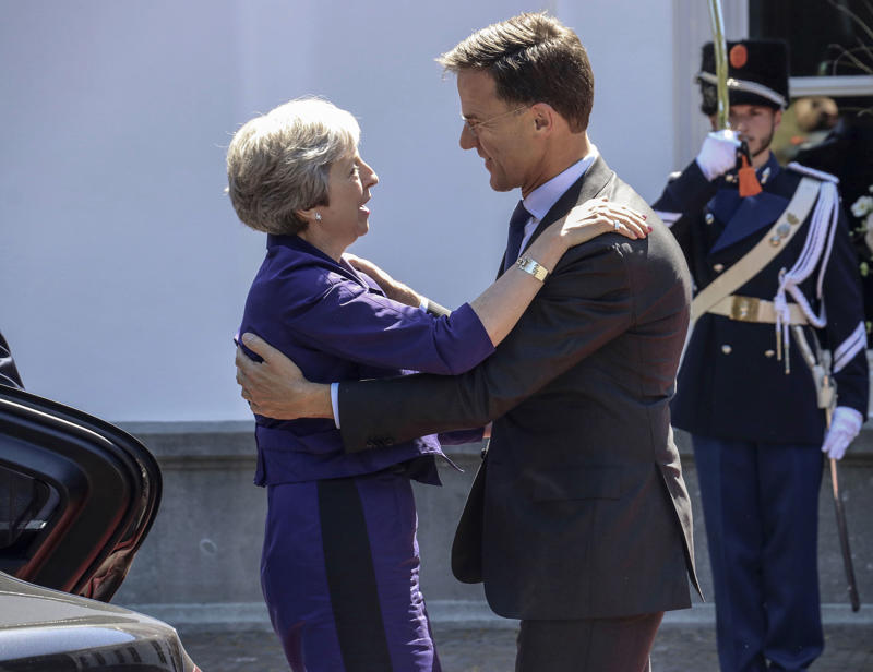 THE HAGUE, NETHERLANDS - JULY 03 : Dutch Prime Minister Mark Rutte (R) welcomes his British counterpart Theresa May (L) for a work lunch at the Catshuis, The Hague, Netherlands on July 3, 2018.  (Photo by Abdullah Asiran/Anadolu Agency/Getty Images)