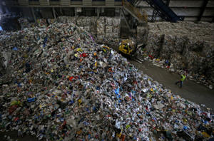 Refuse is piled up at E.L. Harvey & Sons in Westborough, Mass., on May 31, 2018. Trash that once was welcomed by China now could end up in local dumps.