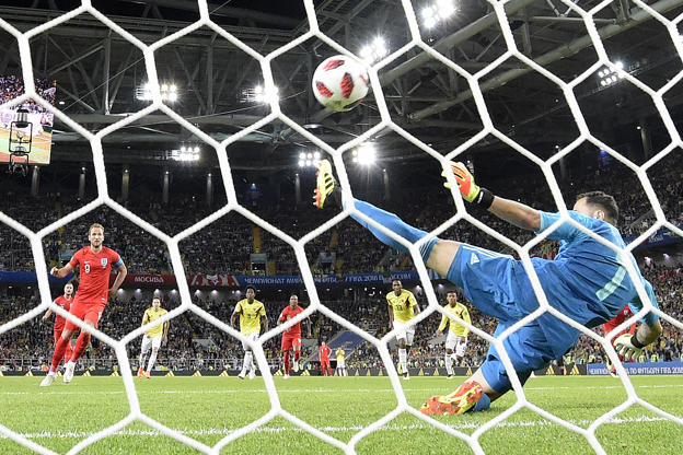 Slide 4 of 109: TOPSHOT - England's forward Harry Kane (L) scores a goal after shooting a penalty kick during the Russia 2018 World Cup round of 16 football match between Colombia and England at the Spartak Stadium in Moscow on July 3, 2018. (Photo by Juan Mabromata / AFP) / RESTRICTED TO EDITORIAL USE - NO MOBILE PUSH ALERTS/DOWNLOADS        (Photo credit should read JUAN MABROMATA/AFP/Getty Images)