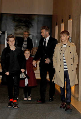 Slide 5 of 38: NEW YORK, NY - FEBRUARY 11:  David Beckham and his children Harper, Cruz and Romeo leave their hotel to attend the Victoria Beckham show on February 11, 2018 in New York City.  (Photo by Pierre Suu/GC Images)