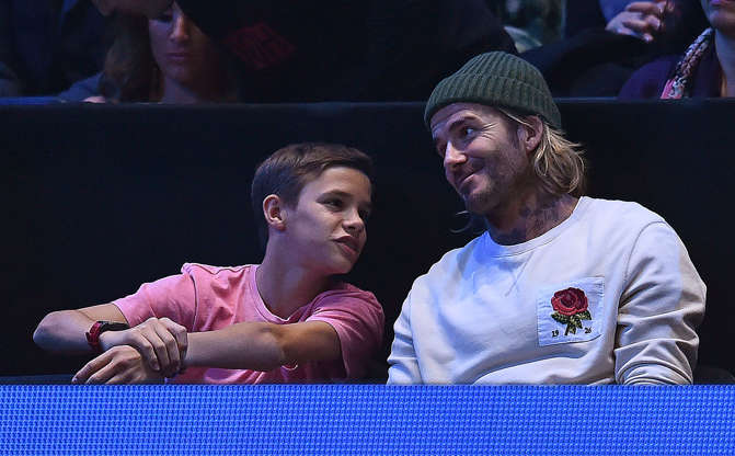 Slide 7 of 38: Former England international football player David Beckham (R), and his son Romeo, watch as Bulgaria's Grigor Dimitrov returns to Belgium's David Goffin during their men's singles final match on day eight of the ATP World Tour Finals tennis tournament at the O2 Arena in London on November 19, 2017. / AFP PHOTO / Glyn KIRK        (Photo credit should read GLYN KIRK/AFP/Getty Images)