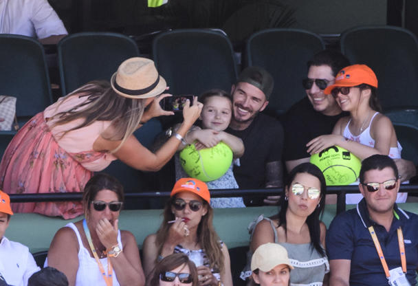 Slide 4 of 38: KEY BISCAYNE, FL - APRIL 01: David Beckham and his daughter  Harper pose for a photo while watching John Isner of the USA against  Alexander Zverev of Germany  in the men's final on Day 14 of the Miami Open Presented by Itau at Crandon Park Tennis Center on April 01, 2018 in Key Biscayne, Florida. (Photo by Mike Frey/Getty Images)