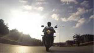 a sunset over a city: Motorcycle safety tips