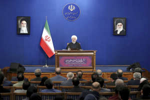 Iran's President Hassan Rouhani gives a press conference in Tehran, Iran, Sunday, Feb. 16, 2020. Rouhani said Sunday  that he doesn't believe the U.S. will pursue war with his country, because it will harm President Donald Trump's 2020 reelection bid. Tensions have been escalating steadily since Trump pulled the U.S. out of Tehran's 2015 nuclear deal with world powers, and reimposed crippling sanctions on Iran. (AP Photo/Ebrahim Noroozi)
