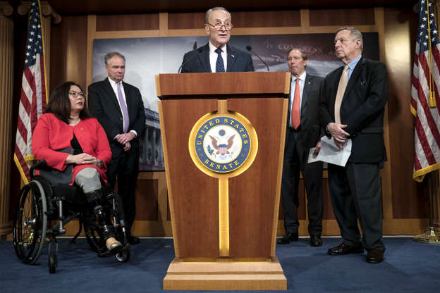 Slide 2 of 48: WASHINGTON, DC - FEBRUARY 13: U.S. Minority Leader Sen. Chuck Schumer (D-NY) speaks during a news conference following the bipartisan Senate vote on the War Powers Resolution on Iran with Senators Tammy Duckworth (D-IL), Tim Kaine (D-VA), Tom Udall (D-NM) and Dick Durbin (D-IL) at the U.S. Capitol on February 13, 2020 in Washington, DC. Some Republicans crossed party lines to join Democrats in voting to freeze President Trump's ability to wage war with Iran, but fell short of the two-thirds supermajority needed to override a promised veto by Mr. Trump. (Photo by Sarah Silbiger/Getty Images)