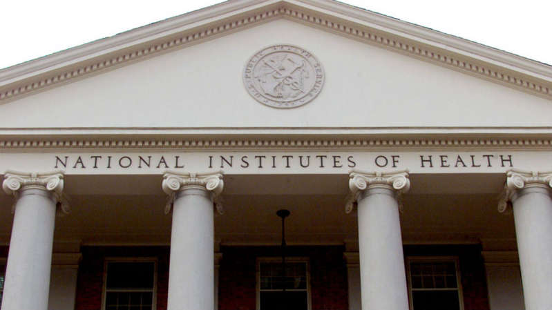 a large white building: NIH funding studies into reports of abnormal menstruation after vaccines