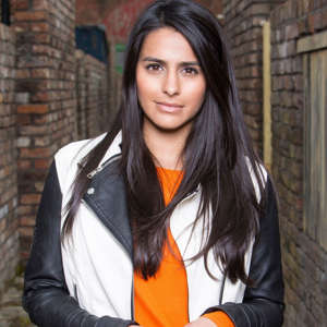 a person standing in front of a building: Sair Khan as Alya Nazir in Coronation Street
