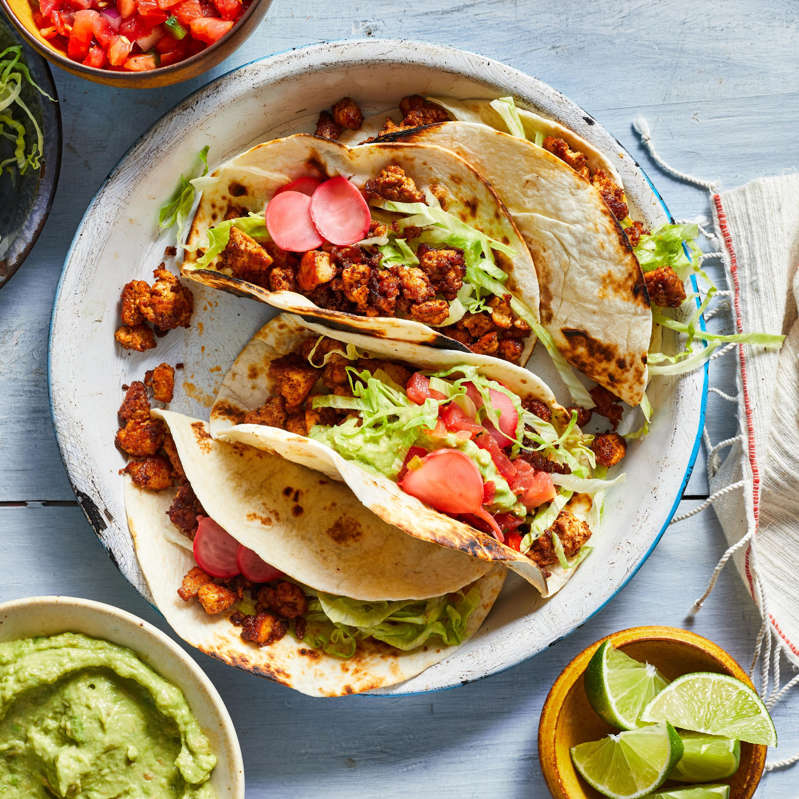 a plate of food on a table: Beefless Vegan Tacos