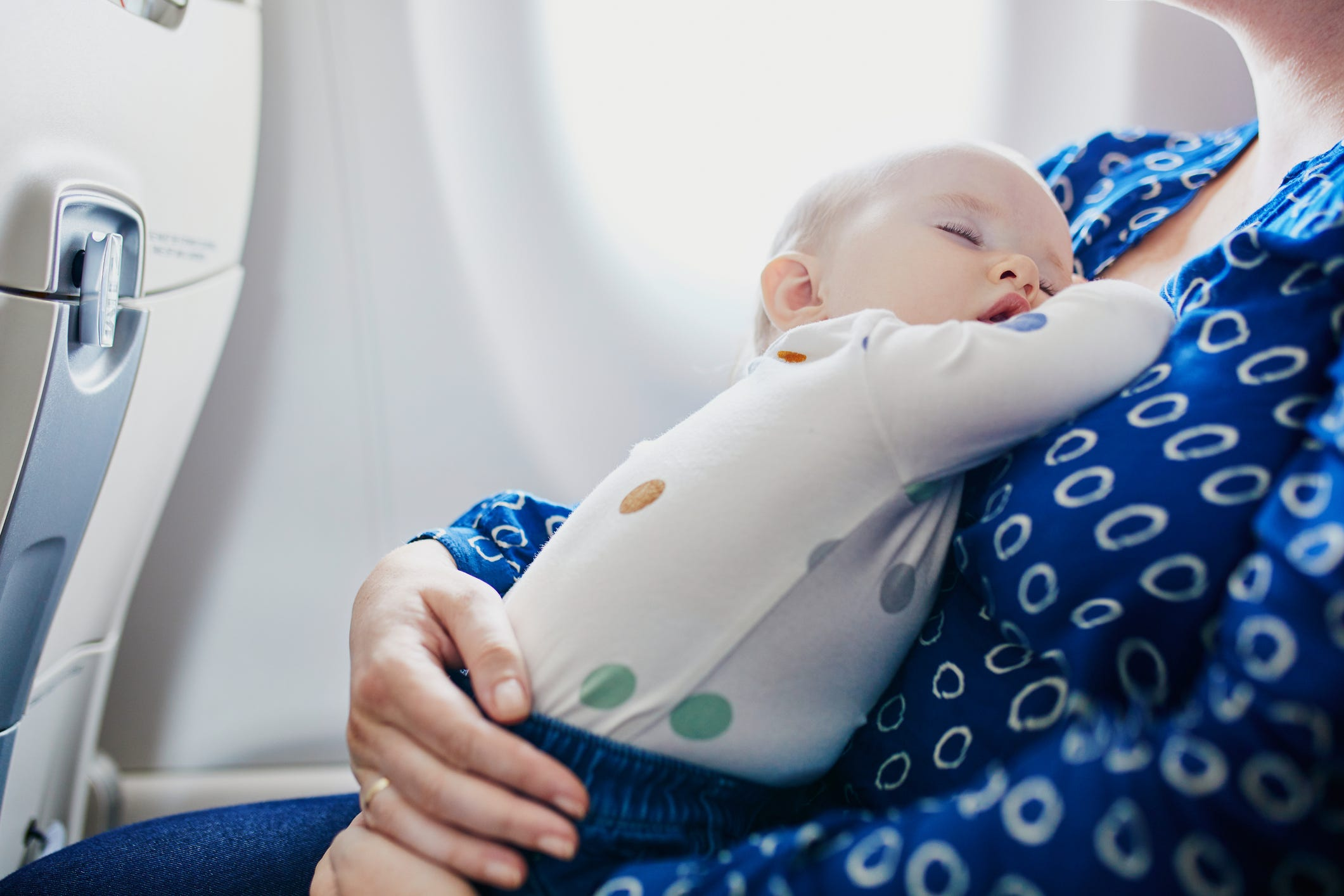 Slide 9 of 85: How can we protect babies and infants from coronavirus sincethey can't wear masks?   The virus is spread by inhaling droplets from an infected person, or by your hands picking up the virus and then touching your eyes.  Keep your child away from people that are sneezing or coughing. Regularly washing their hands and your own for at least 20 seconds after each bathroom trip and before meals will also provide some protection.  Infectious disease experts say both of those tips are better defenses against coronavirus or any influenza-like illness thanthe surgical masks sprouting up at airports around the world.