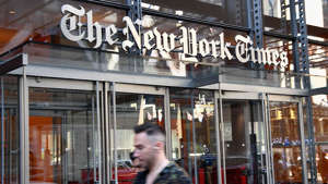 a person standing in front of a store: New York Times dropping 'op-eds' for 'guest essays'