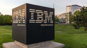 a sign on the side of a building: Sign of IBM with Canada Head Office Building in background in Markham, Ontario, Canada. IBM is an American multinational technology company.