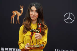 BADEN-BADEN, GERMANY - NOVEMBER 21: Nadia Murad poses with award during the 71th Bambi Awards winners board at Festspielhaus Baden-Baden on November 21, 2019 in Baden-Baden, Germany. (Photo by Thomas Niedermueller/Getty Images)