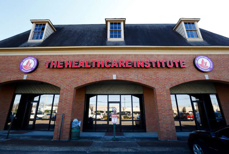 a sign on an awning above a storefront on a brick building: The Healthcare Institute on 7251 Winchester Road in Memphis where the FBI executed search warrants Friday that also included the home of businesses owner, state Sen. Katrina Robinson, a spokesman confirmed.