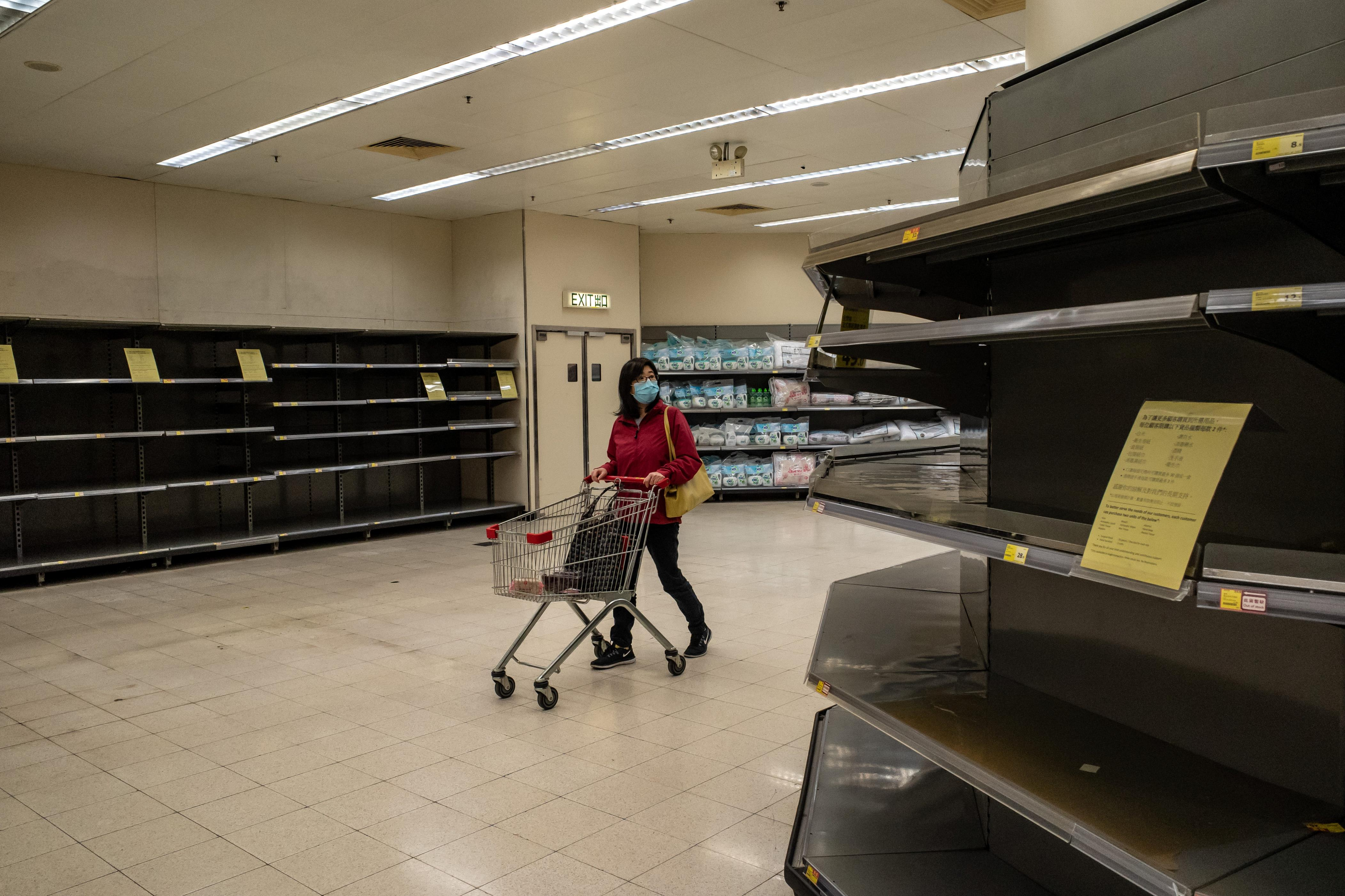 Slide 104 of 113: A shopper wearing face mask pushes a shopping cart in front of an empty shelves inside a grocery store on Feb. 9, 2020 in Hong Kong, China. Hong Kong has 29 confirmed cases of Novel coronavirus (2019-nCoV), with over 37,500 confirmed cases around the world, the virus has so far claimed over 800 lives.
