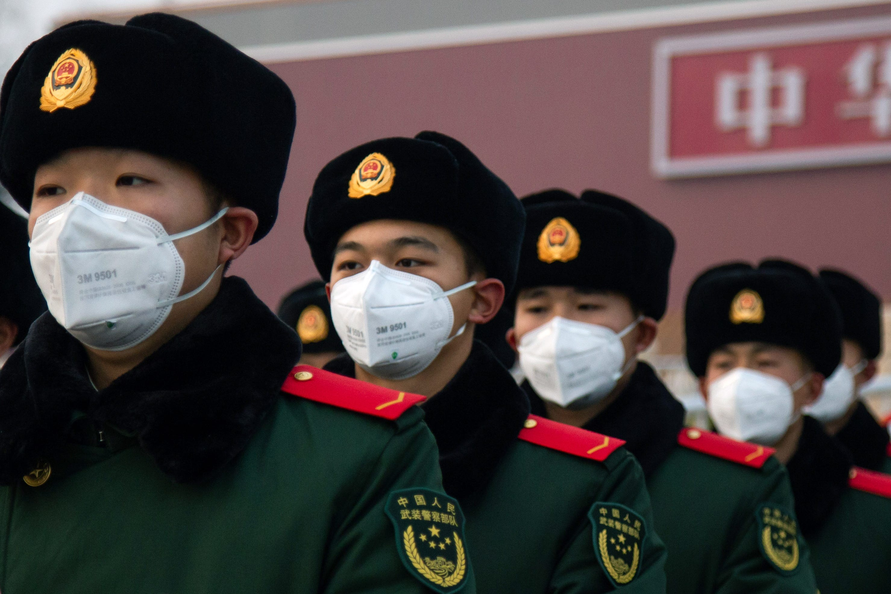 Slide 111 of 113: Chinese police officers wearing masks stand in front of the Tiananmen Gate on Jan. 26, 2020 in Beijing, China. The number of cases of coronavirus rose to 1,975 in mainland China on Sunday. Authorities tightened restrictions on travel and tourism this weekend after putting Wuhan, the capital of Hubei province, under quarantine on Thursday. The spread of the virus corresponds with the first days of the Spring Festival, which is one of the biggest domestic travel weeks of the year in China. Popular tourism landmarks in Beijing including the Forbidden City, Badaling Great Wall, and The Palace Museum were closed to the public starting Saturday. The Beijing Municipal Education Commission announced it will delay reopening schools from kindergarten to university. The death toll on Sunday rose to 56. The majority of fatalities are in Wuhan where the first cases of the virus were reported last month.