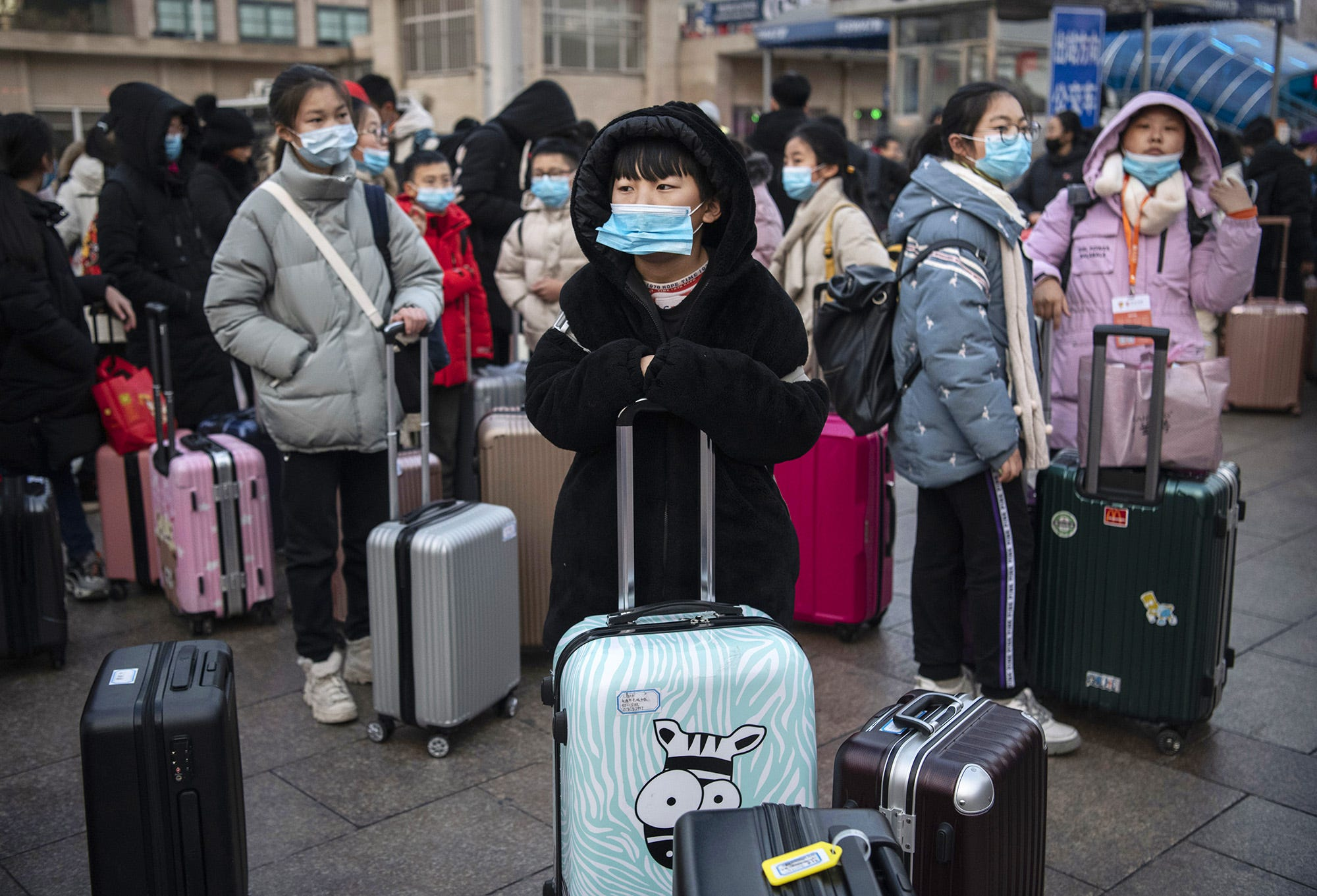 Slide 112 of 113: Chinese children wear protective masks as they wait to board trains at Beijing Railway station before the annual Spring Festival on Jan. 21, 2020 in Beijing, China. The number of cases of a deadly new coronavirus rose to nearly 300 in mainland China Tuesday as health officials stepped up efforts to contain the spread of the pneumonia-like disease which medicals experts confirmed can be passed from human to human. The number of those who have died from the virus in China climbed to six on Tuesday and cases have been reported in other parts of Asia including in Thailand, Japan, Taiwan and South Korea.