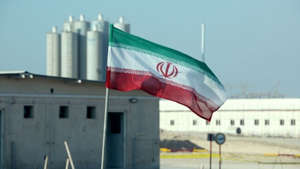 a person standing in front of a building: Iran begins restricting watchdogs' access to nuclear sites: report
