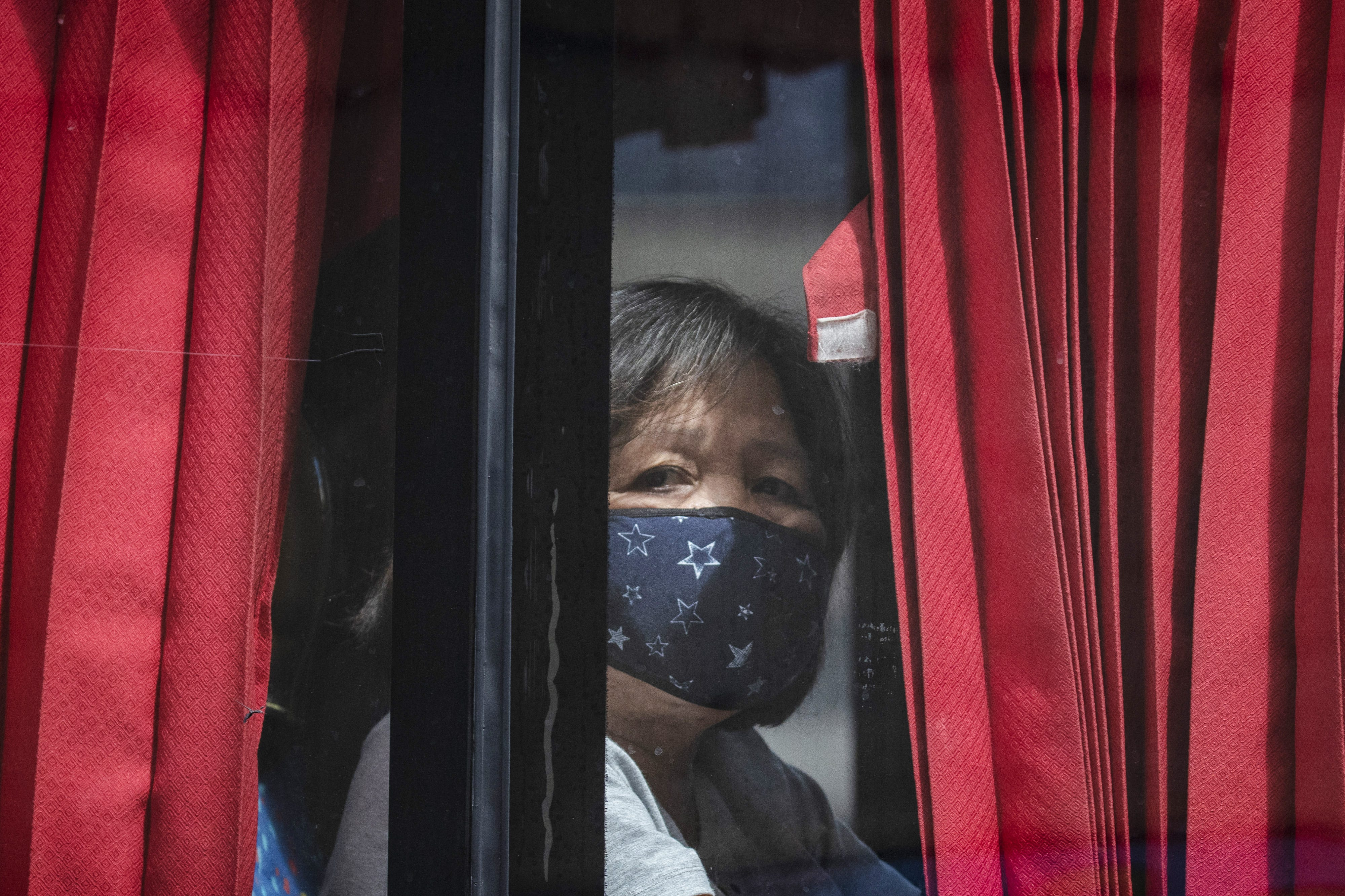 Slide 102 of 113: A woman riding a bus wears a facemask on February 21, 2020 in Quezon city, Metro Manila, Philippines.