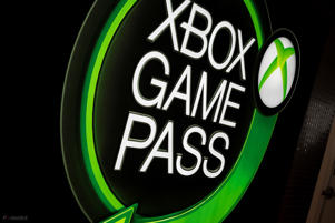 a green and black sign: What Is Xbox Game Pass How It Works Price And All The Games You Can Play image 1