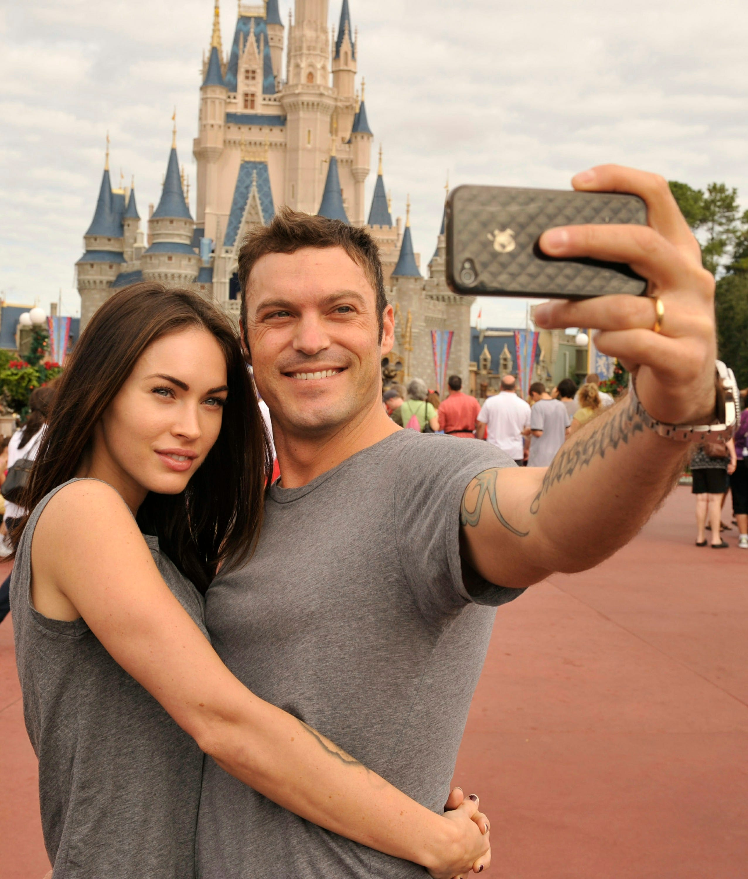 Slide 4 of 8: Actor Brian Austin Green, right, and his wife, actress/model Megan Fox, take a souvenir photo at Magic Kingdom Nov. 26, 2010.